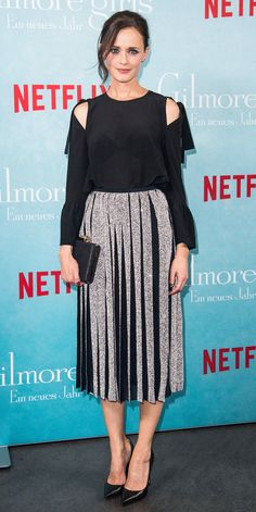 Out and about promoting the new Gilmore Girls reboot, Alexis Bledel trades her Stars Hallow attire for a metallic pleated skirt and exposed shoulder top. Gilmore Girls, Rory Gilmore, Stars Hollow, Kate Hudson, Viria, Celebrity Red Carpet, Celebrity Look, Retro Chic, Netflix