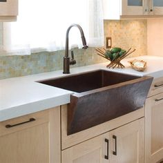 this copper apron sink makes a perfect focal point for kitchens.