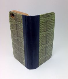 Handcrafted iPhone case made of eel skin, snake skin, paper map, leather, and bamboo. Snake Skin, Bamboo, Iphone Cases, Map, Leather, Location Map, Iphone Case, Maps, I Phone Cases