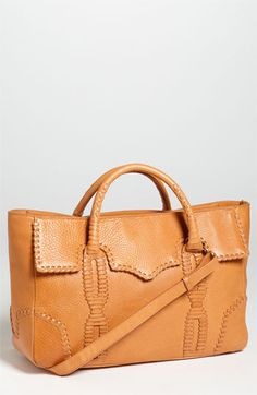 Rebecca Minkoff 'Toki' Tote at Nordstrom.com. Western-inspired whipstitching outlines a structured leather tote topped with rolled handles and an optional shoulder strap.