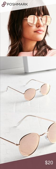 Pink Round Metal Sunglasses Classic rounded sunglasses with shiny metal frames + 100% UVA/UVB tint lenses. Finished with plastic coated tips + silicone nose pads for all day, every day comfort.  Content + Care - Metal, plastic, silicone - Spot clean - Imported Accessories Sunglasses
