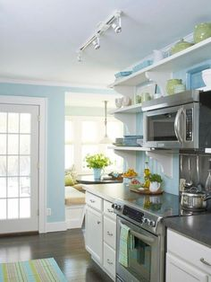 Using a stove with knobs on front instead of back opens space between stove and microwave and looks cleaner.