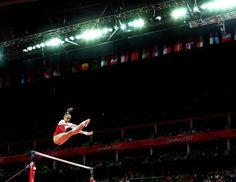 Victoria Komova of Russia competes on the uneven bars in the artistic gymnastics women's team final on Day 4 of the London Olympic Games at North Greenwich Arena, July 31, 2012. (Cameron Spencer/Getty Images)