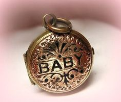 antique gold and enamel baby locket...