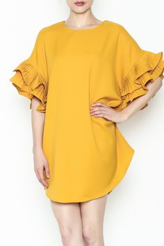 This dress is anything but boring! Turn heads with this bright mustard yellow dress with on-trend ruffle sleeves.   Ruffle Sleeve Dress by On Twelfth. Clothing - Dresses - Mini Clothing - Dresses - Shift Manhattan, New York City New York City