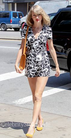 Seen on Celebrity Style Guide: Being friends with model Karlie Kloss must be paying off as Taylor Swift struts her stuff on the streets of New York like it's a runway. The singer is making sure to stay in shape as she hits the gym looking sexy. Taylor was all legs wearing this black and white romper with yellow bag May 17  Get Her Bag Here: http://rstyle.me/~21oNO