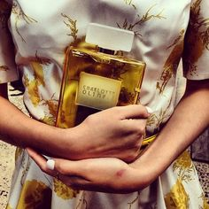 Charlotte Olympia Perfume Bottle Clutch in Yellow