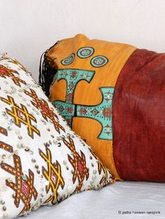 details of a moroccan, hand embroidered cushion & a traditional, Tuareg leather cushion from the deep sahara desert in my home