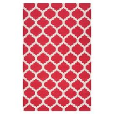 Handcrafted flatweave wool rug with a red quatrefoil motif.   Product: RugConstruction Material: 100% WoolColor: RedFeatures:  Hand-wovenReversible  Note: Please be aware that actual colors may vary from those shown on your screen. Accent rugs may also not show the entire pattern that the corresponding area rugs have.Cleaning and Care: Vacuum regularly with non-beater bar attachment. Blot stains immediately. Spot test any cleaning products. Professionally dry clean.