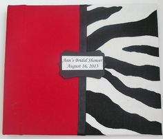 """Small Bridal Shower Guestbook in red cotton fabric and zebra print fabric with a 3/8"""" black double face satin ribbon along the middle of the book accented with a decorative label tag of the bride-to-be name and date of event."""