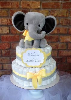 Diaper Cake Elephant 2 Tier Extra Large Stuffed Elephant Baby Shower Centerpiece Diaper cakes start out as beautiful gifts or decorations, often used . Cadeau Baby Shower, Baby Shower Diapers, Baby Shower Cakes, Baby Bump Cakes, Baby Shower Yellow, Baby Shower Fun, Baby Shower Gifts, Shower Party, Elephant Baby Shower Centerpieces