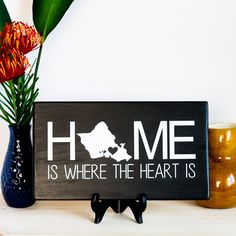 """CUSTOM State Sign - Home is where the heart is sign - Home sign - Home decor - Home State Sign - State Sign - Heart Sign - State Heart Sign. Customize this sign with your personal state. Select from the drop-down box. Two Available sizes. CUSTOM State Sign - Home is where the heart is sign - Home sign - Home decor - Home State Sign - State Sign - Heart Sign - State Heart Sign Sizes: approximately 12"""" x 7"""" and 18"""" x 12"""", sizes may be off by +/- .5"""" Front: paint & sealed Back: sanded and…"""