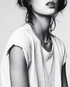 Layered necklaces and a white t-shirt