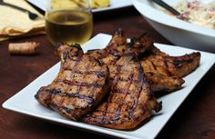 The Juiciest Grilled Pork Chops. Brining helps lean pork stay juicy, while rubs, pastes, and marinades boost flavor Jamaican Pork Chops Recipe, Bone In Pork Chop Recipe Grill, Paleo Pork Chops, Easy Pork Chop Recipes, Pork Loin Chops, Pork Cutlets, Jamaican Recipes, Steak Recipes, Marinated Pork Chops Grilled