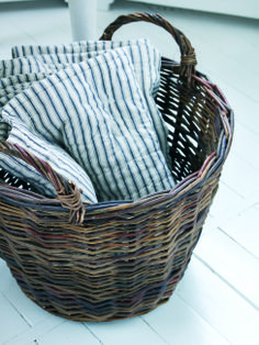 blue + white striped throw blanket in a basket | bedding + home decorating ideas