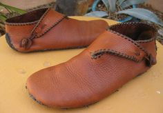 Making leather shoes. This is a 10th century Scandinavian style of shoe called turn-shoes because you make them inside out them turn then right-side out