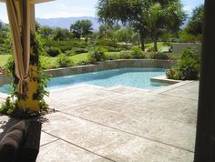 Luxury swimming pool with a stamped concrete pool deck. - mediterranean - pool - los angeles - Sarah Tate
