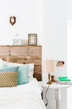 wood bed + white bedside table