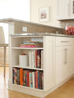If you're an avid cook, keep your favorite cookbooks out and easily accessible with a small built-in bookshelf. Although islands are popular choices for kitchen bookshelves, this version makes use of a bit of empty space at the end of a stretch of cabinetry.
