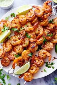 This Grilled Spicy Lime Shrimp with Creamy Avocado Cilantro Sauce recipe from The Recipe Critic is a simple yet full of flavor recipe! ,Grilled Spicy Lime Shrimp with Creamy Avocado Cilantro Sauce, Kebab Recipes, Grilling Recipes, Cooking Recipes, Healthy Recipes, Easy Cooking, Cooking Food, Grilling Ideas, Barbecue Recipes, Avocado Recipes