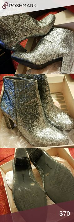 BCBG Silver Glitter Booties! Super Glittery!!! BCBGeneration! You can pair these beauties with different looks. Versatile enough for casual and dress, BCBGeneration provides the unlikely combination of maturity and playfulness in every style. Worn once! Great Condition ~ Heel 2.5 ~  No Trades! BCBGeneration Shoes
