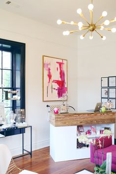 Pretty pink and cream abstract art - love the white wood topped counter in this nail salon, too!