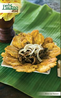 TOSTONES CON BISTEC contiene 8 tostones servido con carne y o ensalada. Restaurante El Plátano 494 en Isabela , Puerto Rico.