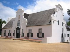 The Groot Constantia Manor house today houses a museum. Situated on the Groot Constantia wine farm near Cape Town, South Africa, it is declared a heritage site. South Africa Tours, Cape Town South Africa, Dutch Gable Roof, Cape Town Tourism, African Museum, Cape Dutch, The Gables, Historic Homes, Homesteading