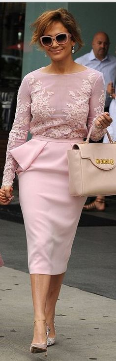 Lace top, pink peplum skirt, handbag, and floral pumps that she wore in New York on July 10, 2014