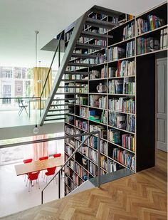 bookcase stairwell central wall : This Rotterdam townhouse is tall and narrow, but by pushing storage to the side, Shift enabled it to feel bright and open with continuously-flowing, open-riser stairs.