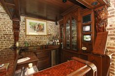 Awesome mancave bar complete with cabinet hutch and totally cool corbels! Greater Charleston SC Luxury Home Listings