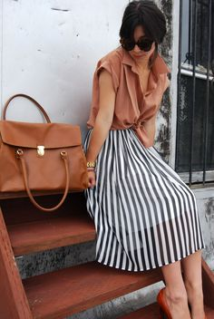 striped skirt with a romantic blouse
