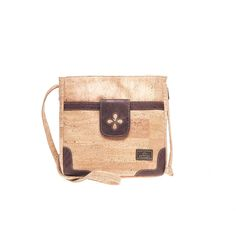 Vegan Cork Crossbody Bag with a cut out flower detail, contrasting in color. Eco-friendly, durable and made in Portugal. Montado – Cork Fashion.