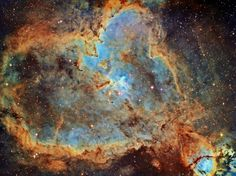 Sprawling across almost 200 light-years, emission nebula IC 1805 is a mix of glowing interstellar gas and dark dust clouds. Derived from its Valentine's-Day-approved shape, its nickname is the Heart Nebula.