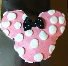 Minnie mouse red velvet cake with pink cream cheese frosting. Marshmallow poka dots and fondant bow