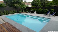 Image result for light grey pool surround with turquoise tiles