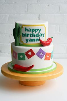 Papel picado cake with fondant peppers by Erica OBrien Cake Design