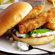 Posh fish finger sandwiches: Nothing beats a fish finger sandwich. We've added homemade tartare sauce, brioche buns and peppery rocket to posh this version up