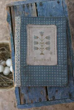 """Hollyhock Journal"" is the title of this cross stitch pattern from Stacy Nash Primitives that is stitched with DMC threads."