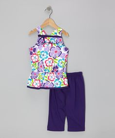 This Purple Floral Tunic & Capri Leggings - Infant, Toddler & Girls by G&J Relations is perfect! #zulilyfinds