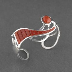 Cuff | Ted Draper, Jr. (Navajo).  Sterling silver, inlaid with natural red coral