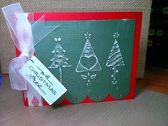 Sizzix embossing folder for trees on white core paper that I sanded to expose, Fiskars large scallop scissors, dollar bin ribbons and my own lettering on the tag.