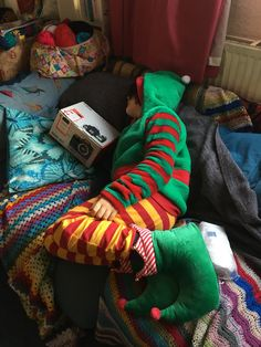 If you would like to replicate this elf look it's comprised of *the bottoms of the Hogwarts pyjamas I got for Chiswick Boy's birthday, plus elf slippers and elf snuggly hoodie – both from Tescos.