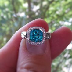Stunning blue zircon and diamond ring in 18K white gold to brighten up the Monday blues.  www.zomacolor.com