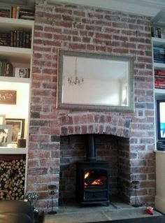Excellent Snap Shots Brick Fireplace log burner Concepts Often it will pay for you to miss a remodel! Instead of pulling out the out of date brick fireplace , spend less but sti Brick Fireplace Log Burner, Exposed Brick Fireplaces, Fireplace Hearth, Fireplace Design, Fireplace Ideas, Brick Hearth, Living Room Ideas Red Brick Fireplace, Fireplaces Uk, Kitchen Fireplaces