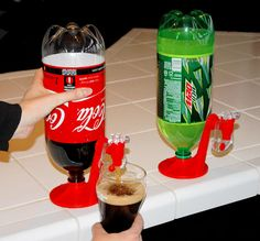 Fizz saver 2 liter soda dispenser,Fizz will last until the bottle is empty. 1 x Soda Fizz Saver Dispenser. Simply twist dispenser onto the top of a plastic bottle, then invert the bottle to dispense drinks into your glass. Drink Dispenser, Water Dispenser, Beer Dispensers, Inventions Sympas, Ideas Para Inventos, Take My Money, Gadgets And Gizmos, Cheap Gadgets, Useful Gadgets