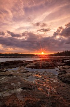 The sun sets over low tide pools at the end of the Wonderland Trail in Acadia National Park Maine