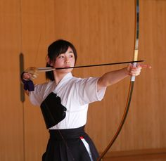 Kyudo practice for a fit woman.