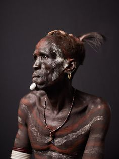 Africa | 'Study of Biwa Bermo'. The Karo are considered one of the Omo Valley's most endangered ethnic groups with an estimated population of only 1500 remaining.   Biwa is an elder of the Karo tribe. He has participated in many raids and battles over land to define tribal borders.  Lower Omo Valley, Ethiopia | © Joey L