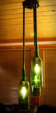 Recylced Wine Bottle ChandelierThree's a Crowd by hmsc93 on Etsy.. I want to buy this for my house SOOO bad!